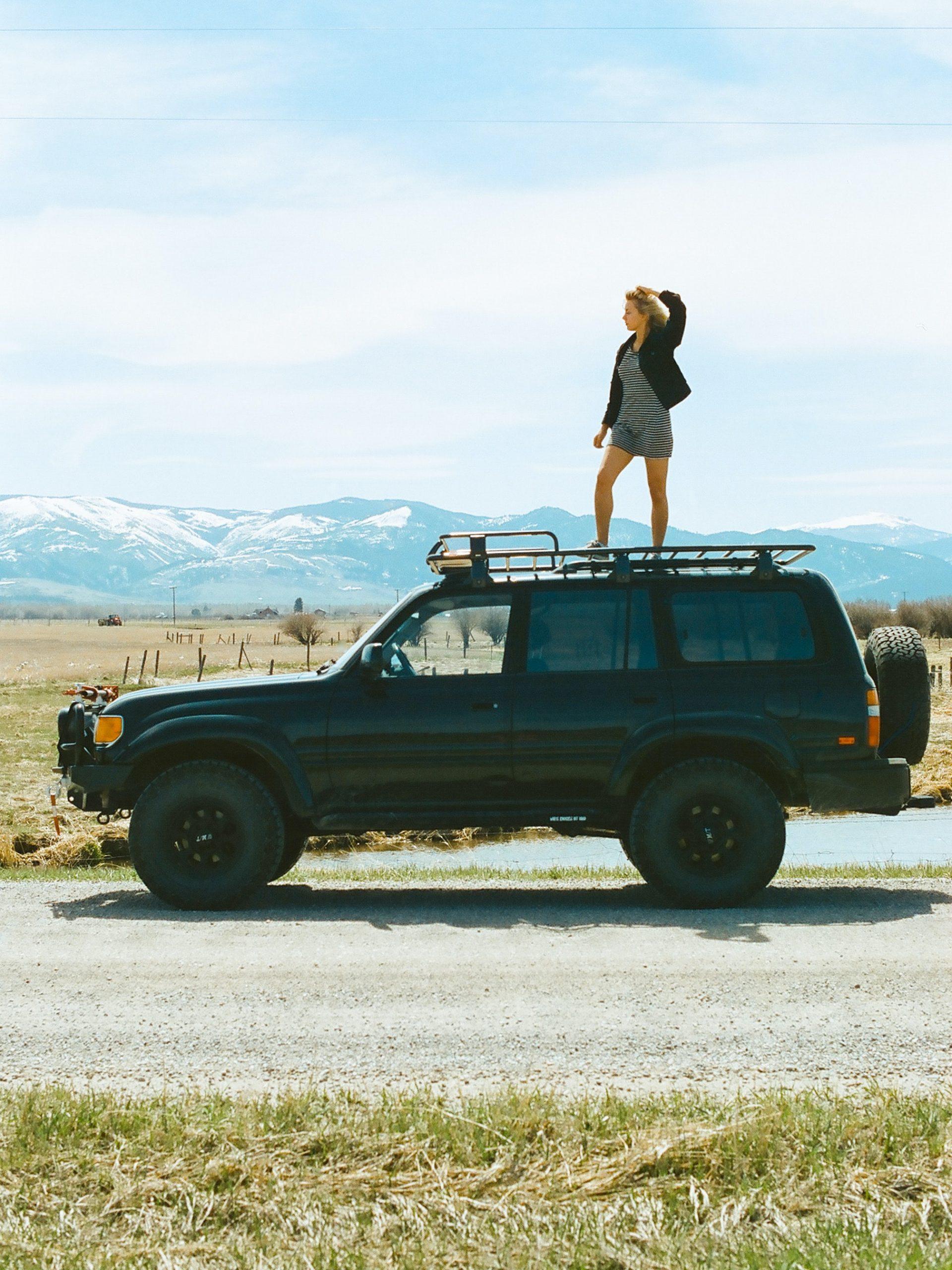 79 Series Landcruiser Upgrades - woman standing on car