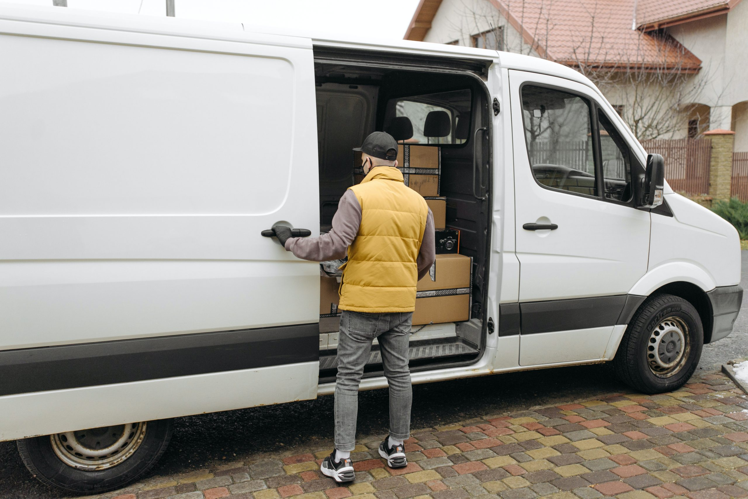 Instant Asset Write Off Scheme - white delivery van with driver