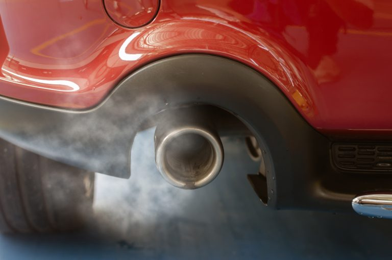 Why You Need an Oil Catch Can with Your EGR System - close up of a car exhaust