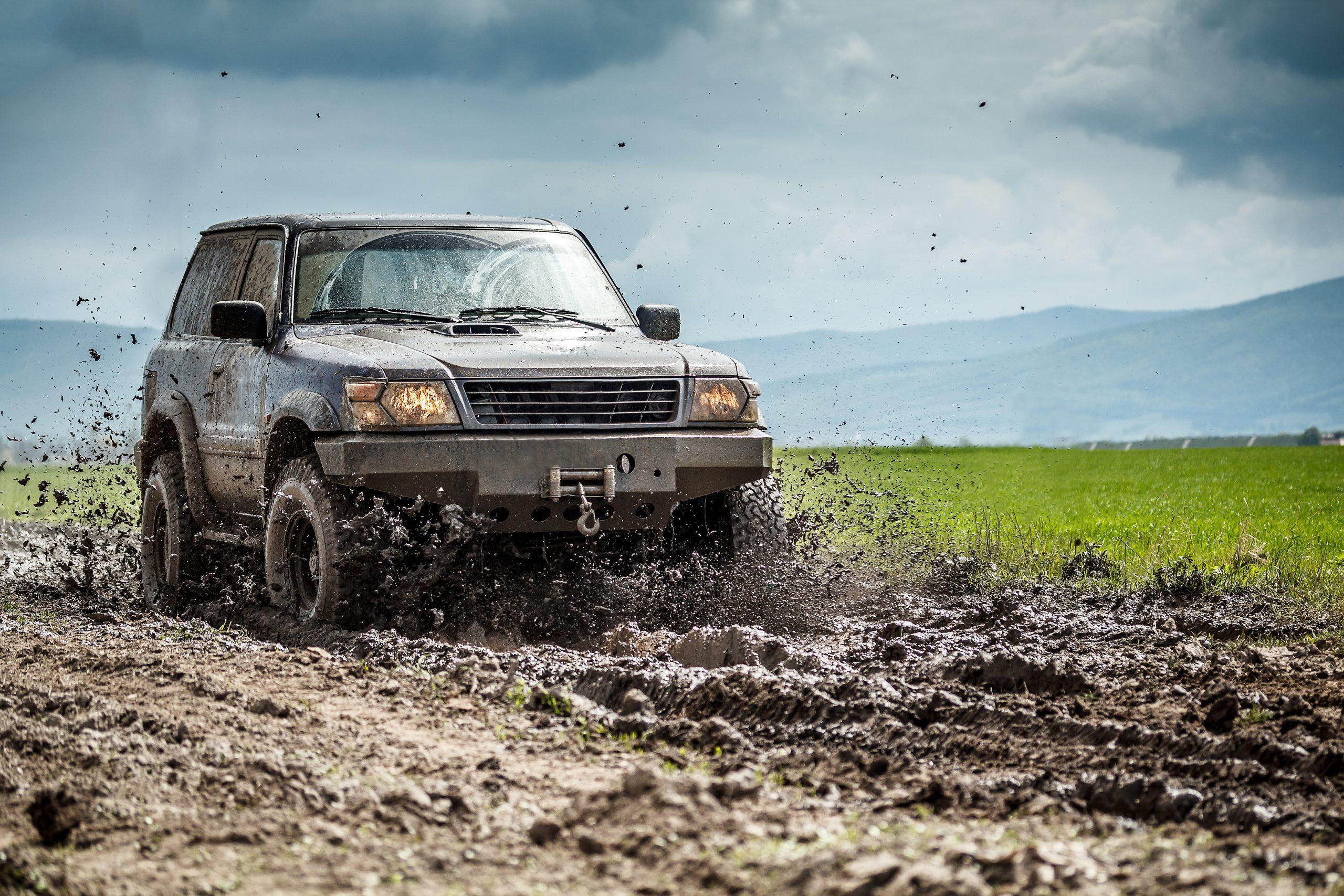 5 Ways to Boost Diesel Engine Performance  - car sliding through mud